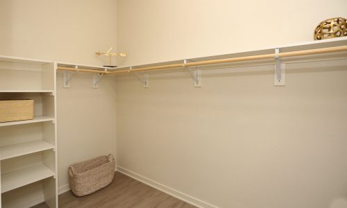 Large Walk In Closet with Clothing Hanging Space