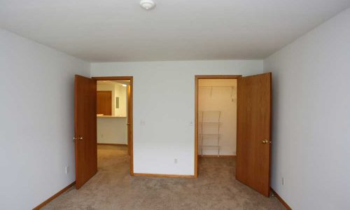 Bedroom with Doors to Living Room and Closet
