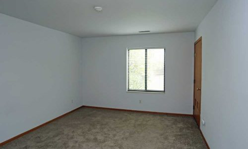 Carpeted Bedroom with Single Window